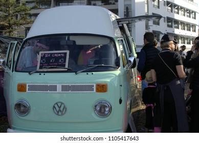 People standing around Vintage Volkswagen Kombi ice cream van in Sydney Taste of Manly festival in Australia as on 27 May 2018. Concept of food business doing good
