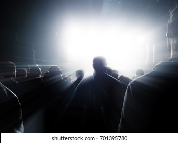 People standing in front of a maxi screen brightly lit