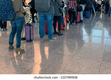 people standing in line at the airport on board the aircraft