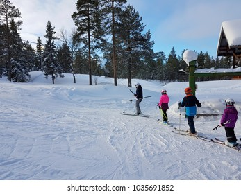 People standing in line for a small skii lift in Söten, Sweden