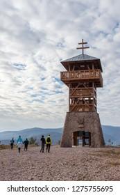 People standing next to a view tower Haj in Nova Bana Slovakia