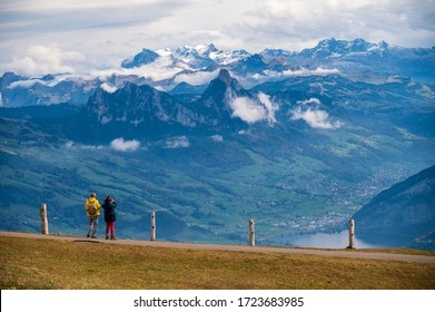 People standing at the view point at Rigi Kulm looking down to the mountains.  Rigi Kulm, Luzern, Switzerland.