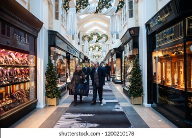People stroll in the Burlington Arcade shopping centre in London on November 21, 2013. It is one of the best-known London shopping arcades at Christmas in the heart of Mayfair
