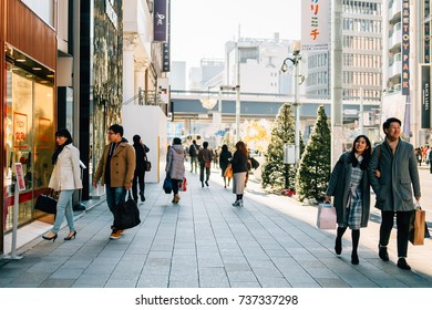 People strolling, relaxing in the walking street of Ginza area, Tokyo, Japan on Christmas's day - December 2016