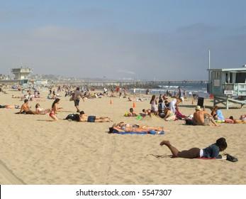 People sunbathing at Venice Beach