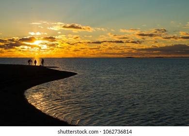 People in sunset, Saaremaa, Estonia