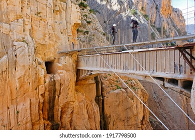 People in suspended track in the Caminito del Rey gorge in Spain