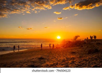 People in Swakopmund, Namibia enjoying the sunset at the beach - Shutterstock ID 796504123