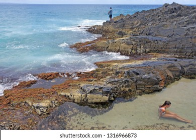 People swim and fish in Fairy Pools in Noosa, Sunshine Coast, Queensland, Australia