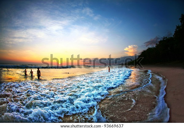 People Swimming in Ocean During Sunset in Costa Rica