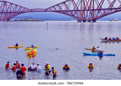People swimming in the sea on New Years Day in Queensferry, Fife. A local tradition called The Loony Dook. Fife, Scotland UK January  2018