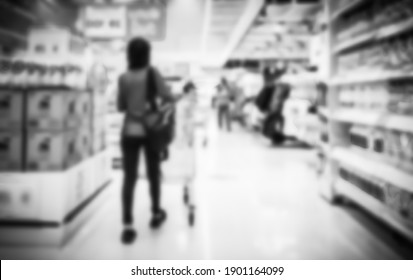 People take a cart shopping in Supermarket