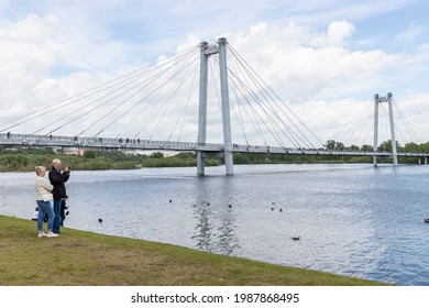 People take pictures of the Yenisei River in the area of the cable-stayed bridge in the flooded zone. Russia, Krasnoyarsk June 6, 2021