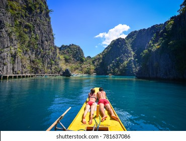 People take a sunbath on the boat in Coron Islands, Philippines.
