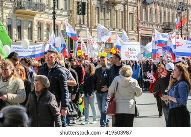 People taking part in the demonstration. St. Petersburg, Russia - 1 May, 2016. Day festive demonstration on the Nevsky Prospect in St. Petersburg, the first of May