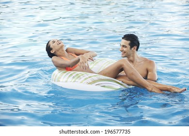 people taking a rest at swimming pool in resort