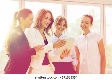 people, technology, work and corporate concept - business team of women with tablet pc computer at office