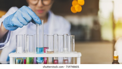 People with test tube. Woman chemist examines test tube