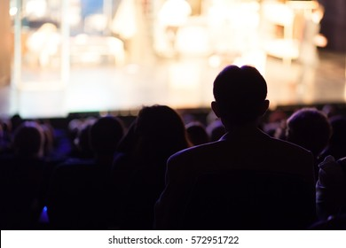 people at the theater