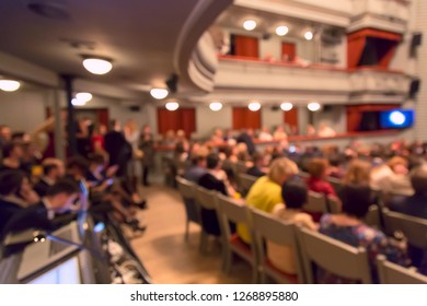 People in the theater auditorium during the performance. Blurred image