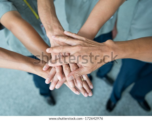 People with their hands together. team work concept