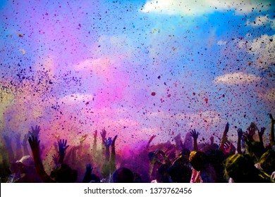 People throwing color powders in the air as part of Color Run celebration