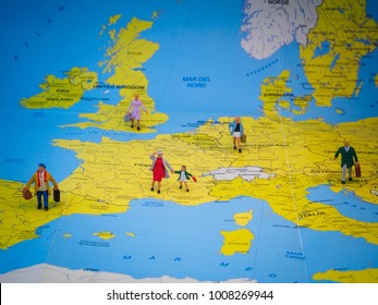 People tiny figures standing on a Europe map. They represent the migration problem in the region.