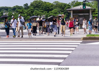 People in Tokyo cross the Street in Japan 2018.