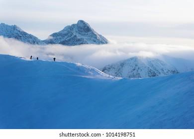 People at the top of Kasprowy Wierch in Zakopane in Tatras in winter. Zakopane is town in Poland in Tatra Mountains. Kasprowy Wierch is a mountain in Zakopane and the most popular ski area, Poland