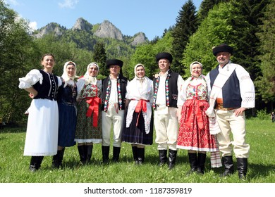 People in traditional clothes at a traditional Folk Dance Festival in the town of Cerveny Klastor in Slovakia in east Europe.     Slovakia, Cerveny Klastor, May, 2009
