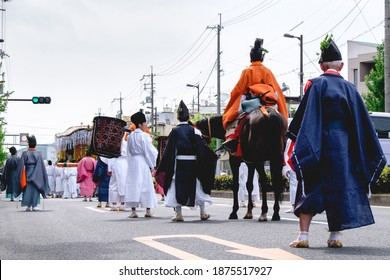 People with traditional costumes of Heian period at Aoi Matsuri parade, Kyoto - Shutterstock ID 1875517927