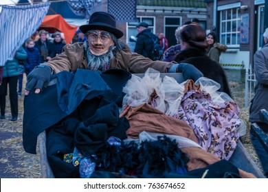 People  in traditional customs at the streets of the old town of Urk relive the years of 1910-1920 Wintersferen a yearly event at Urk Netherlands November 2017