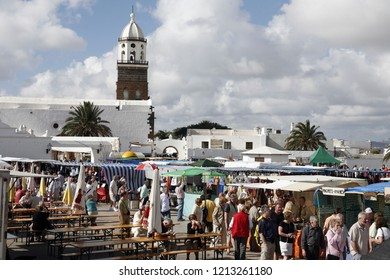 people at the traditional sunday market in the old town of Teguise on the Island of Lanzarote on the Canary Islands of Spain in the Atlantic Ocean.    Canary Islands, Lanzarote, February, 2006