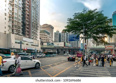 People and traffic in downtown Shenzhen, China - April 2018