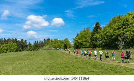 People trailrunning in beautiful mountain landscape