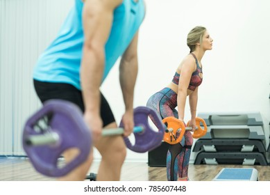 People training body pump and isometric exercises at gym