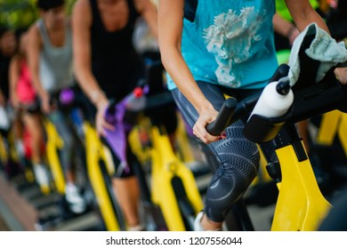 People training at a gym doing cyclo indoor. Sports and fitness concept.