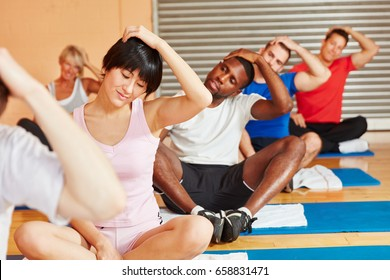People training making pilates exercise in fitness center