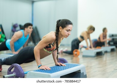People training push ups exercises at gym