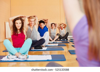 People training in Stretching course in fitness center
