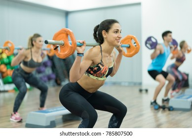 People training with weights at gym