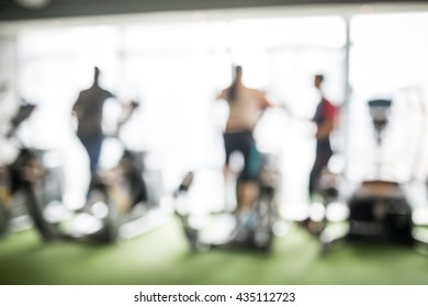 people in a trainnig course at fitness in blur scene