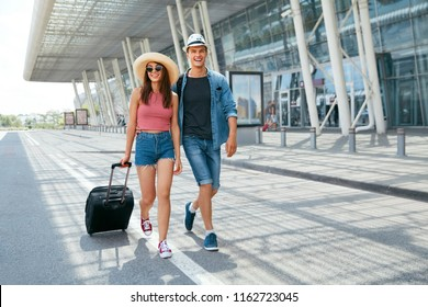 People Travel. Couple Near Airport, Traveling On Vacations. Beautiful Young Couple Going On Summer Trip. High Resolution