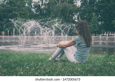 People, travel and summer holidays concept. Young woman in the beautiful green garden enjoy the view of the fountain. Mestsky or City park of Kosice, Slovakia (Slovensko), vintage image - Shutterstock ID 1472005673