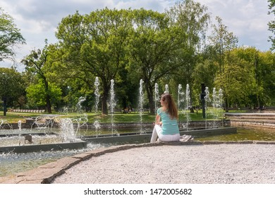 People, travel and summer holidays concept. Young woman in the beautiful green garden enjoy the view of the fountain. Mestsky or City park of Kosice, Slovakia (Slovensko) - Shutterstock ID 1472005682