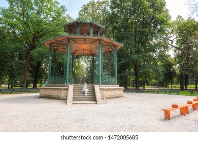 People, travel and summer holidays concept. Young woman posing in the beautiful green garden pavilion. Mestsky or City park of Kosice, Slovakia (Slovensko) - Shutterstock ID 1472005685