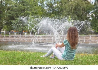 People, travel and summer holidays concept. Young woman in the beautiful green garden enjoy the view of the fountain. Mestsky or City park of Kosice, Slovakia (Slovensko) - Shutterstock ID 1472005691