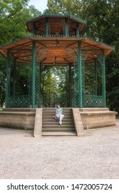 People, travel and summer holidays concept. Young woman posing in the beautiful green garden pavilion. Mestsky or City park of Kosice, Slovakia (Slovensko), vertical image - Shutterstock ID 1472005724