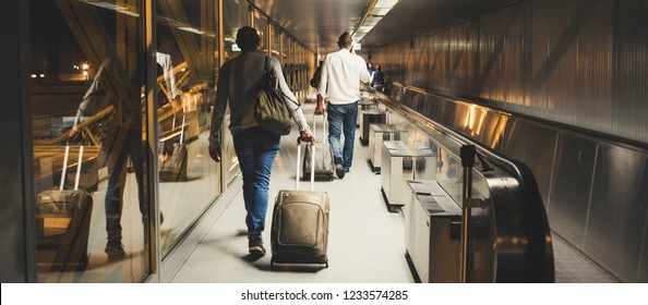 People travelers in the airport ready to flight or just arrived to the new destination. work or business travel concept for mixed people moving inside the gate