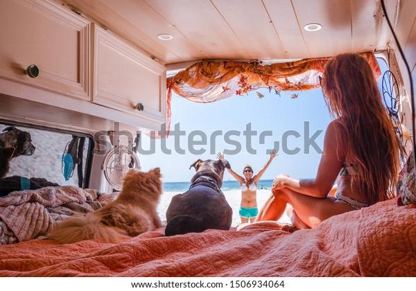 People traveling in a camper van - Vanlife